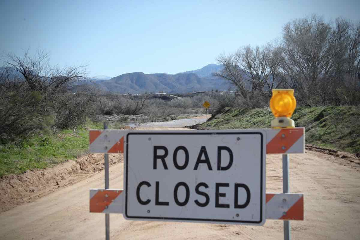 Do not attempt to cross if the road is closed