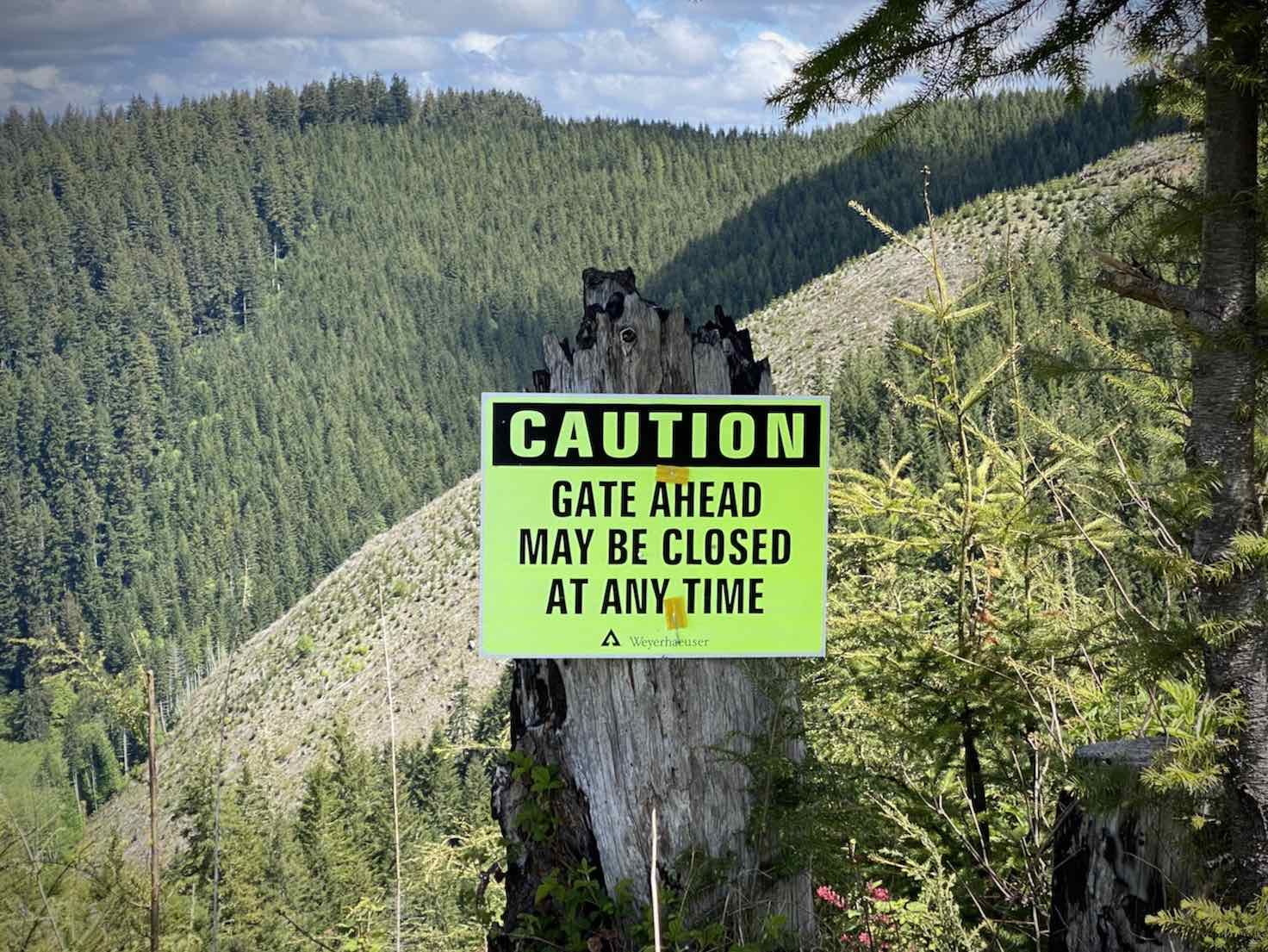 Weyerhaeuser sign for gate could be closed at any time.