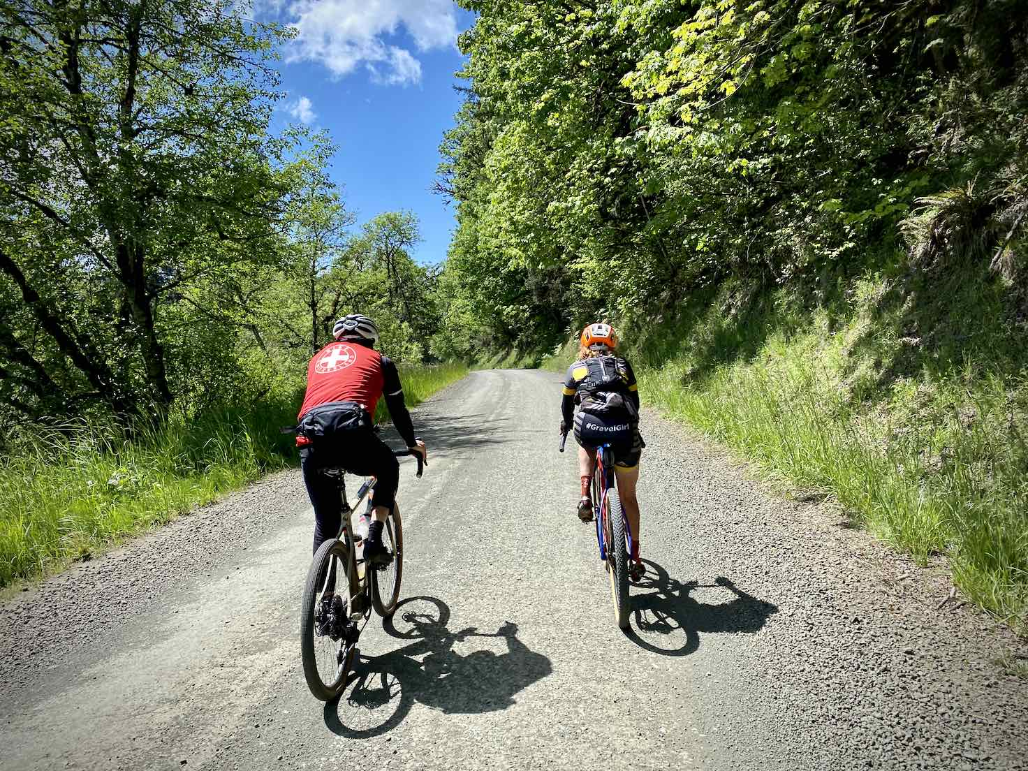 Two cyclists riding the gravel road towards Big Elk campground.