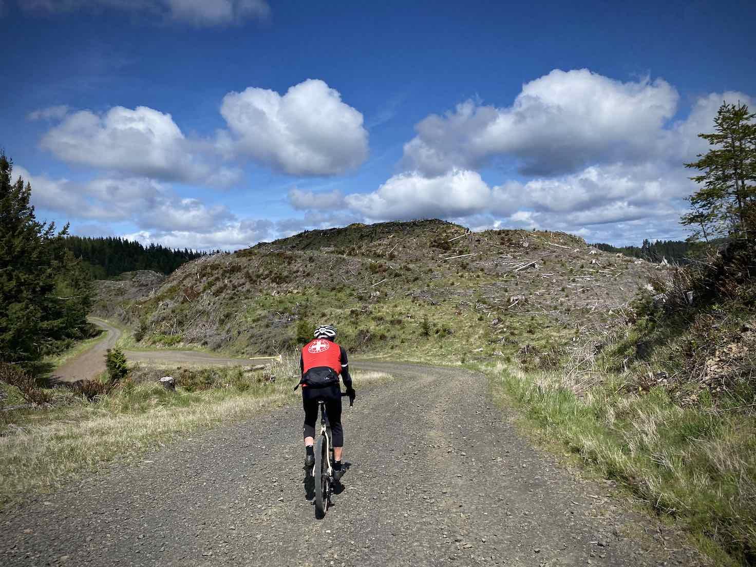 Gravel cyclists descending a rugged Weyerhaeuser road in Oregon.