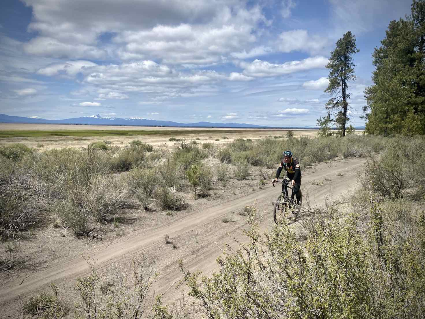 A view of cyclist riding dirt road just west of the Klamath Marsh.