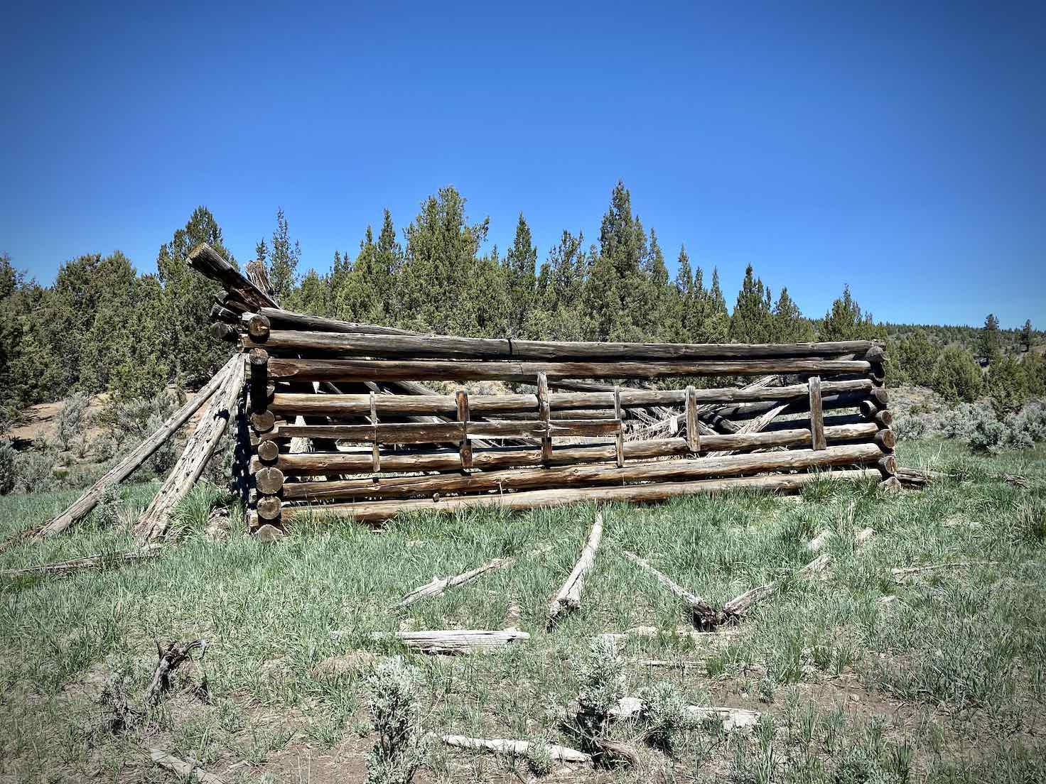 A historic log structure along Little Bear Creek Road.
