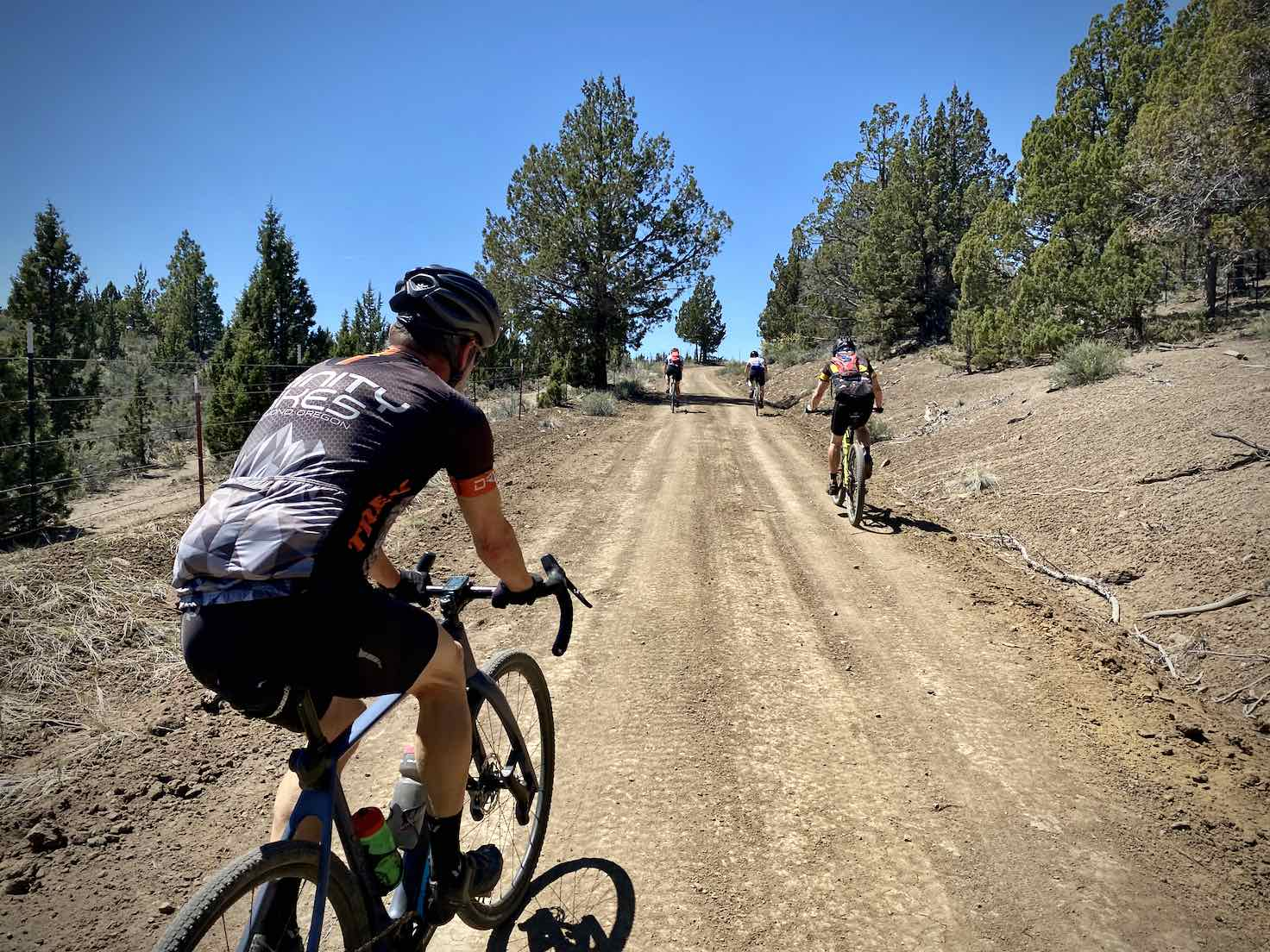 Gravel cyclist climbing steep pitch on Roberts road in Central Oregon.