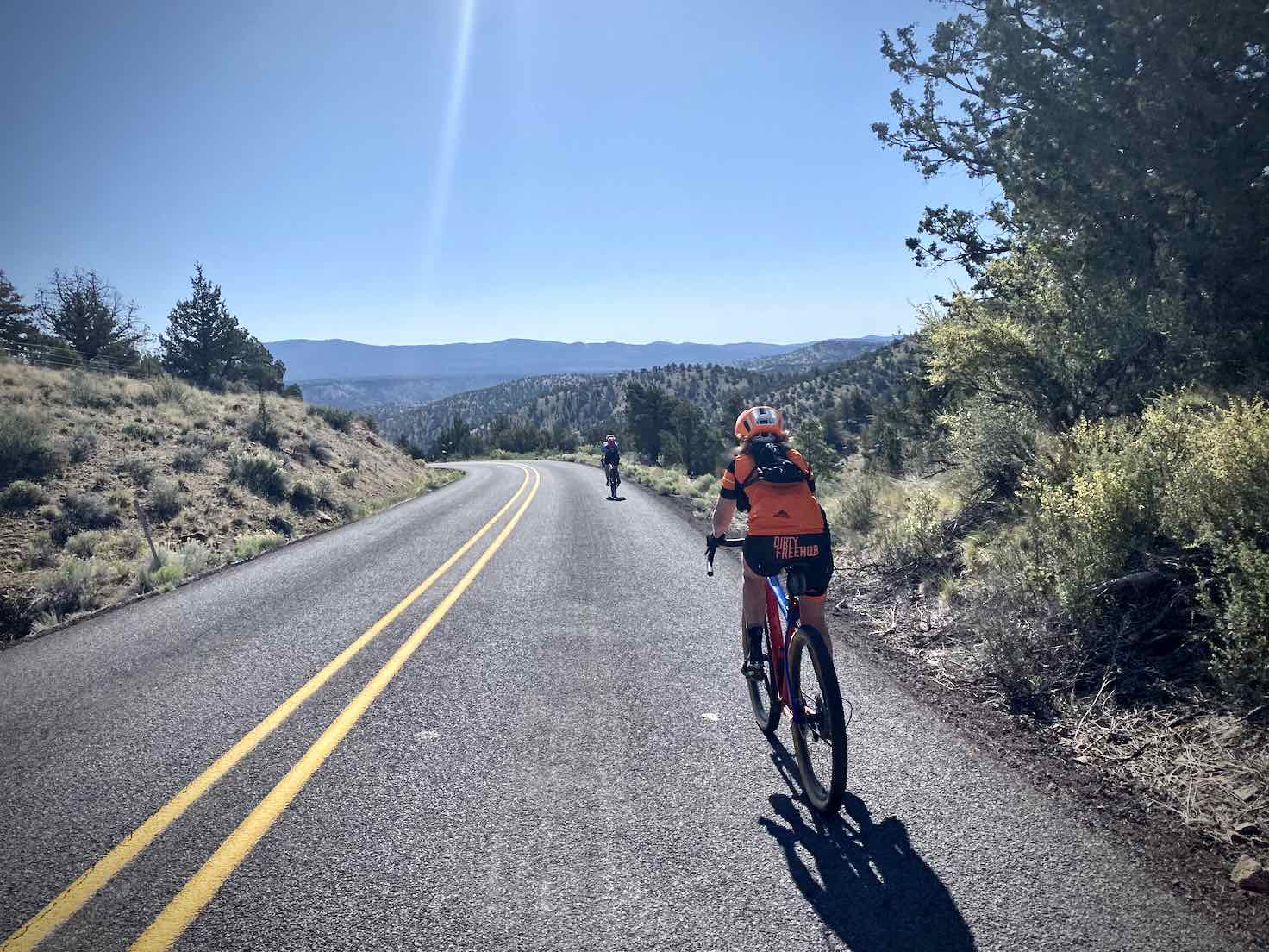 Cyclists leading out over the hill on the Crooked River Highway south of Prineville Reservoir.