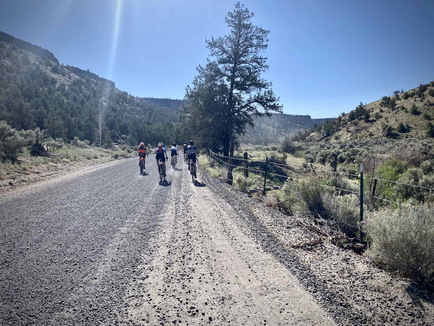 Cyclists on the gravel portion of the Crooked River Highway.