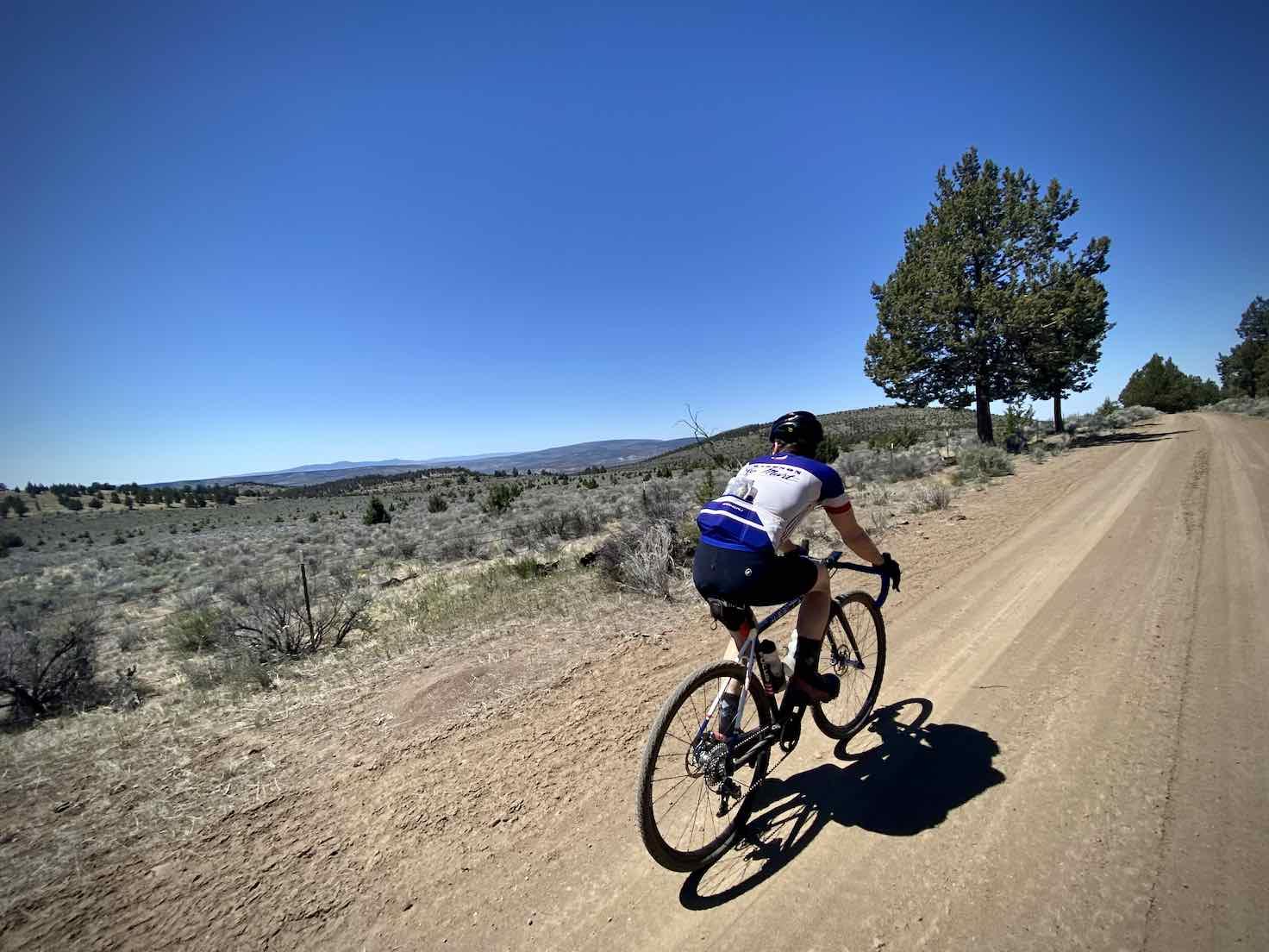 Cyclist riding the ridge with big views along Roberts Road.