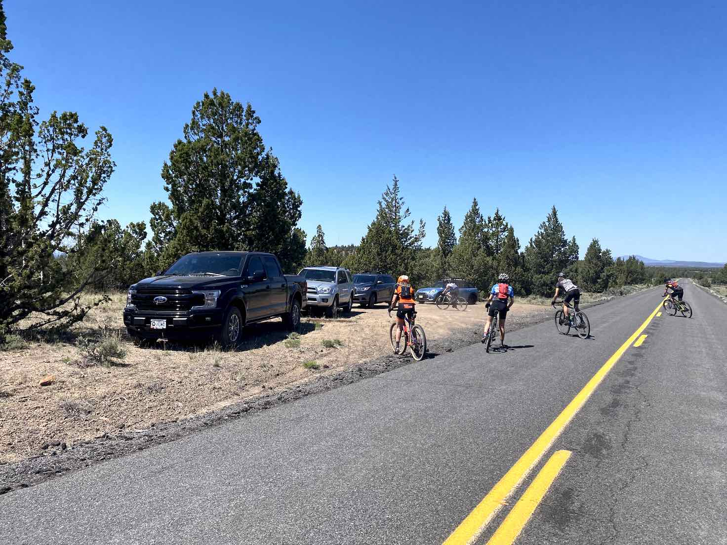 Cyclists ending ride at pull out along the highway.