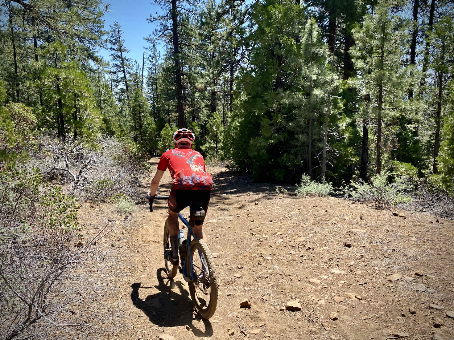Old abandoned gravel road on Black Butte with gravel cyclist.